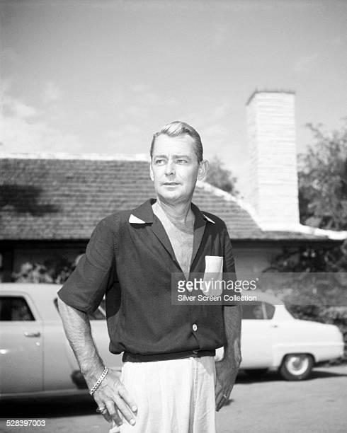 American actor Alan Ladd , wearing a two-tone shirt, circa 1955.