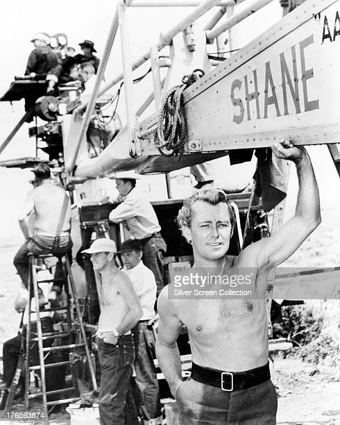 American actor Alan Ladd with a film crew on the set of 'Shane', directed by George Stevens, 1953.
