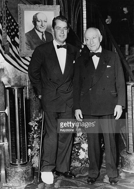 American actor Alan Ladd with film mogul Adolph Zukor at the Paris premiere of Ladd's latest film 'Shane', France, 16th October 1953. Ladd had...