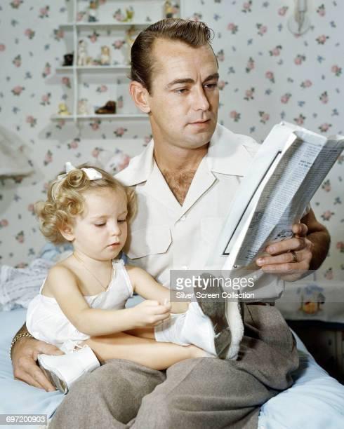 American actor Alan Ladd with his daughter Alana, circa 1945.