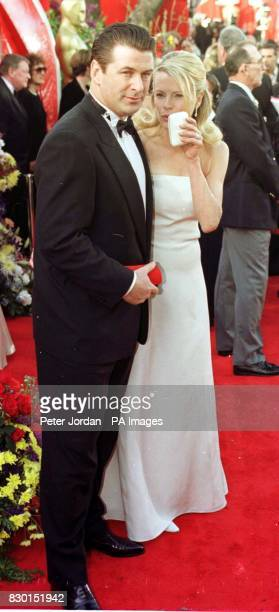 American actor Alec Baldwin with his wife, actress Kim Basinger, at the Dorothy Chandler Pavilion in Los Angeles for the 71st annual Academy Awards....