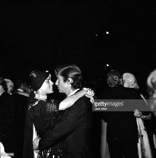 American actor Ali MacGraw dances with her husband producer Robert Evans at an Academy Award after party Los Angeles California April 7 1970