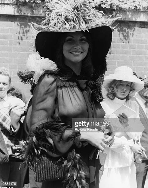 American actor and adult film star Linda Lovelace attends the Ascot races in a sheer black chiffon blouse, England, June 20th 1974.