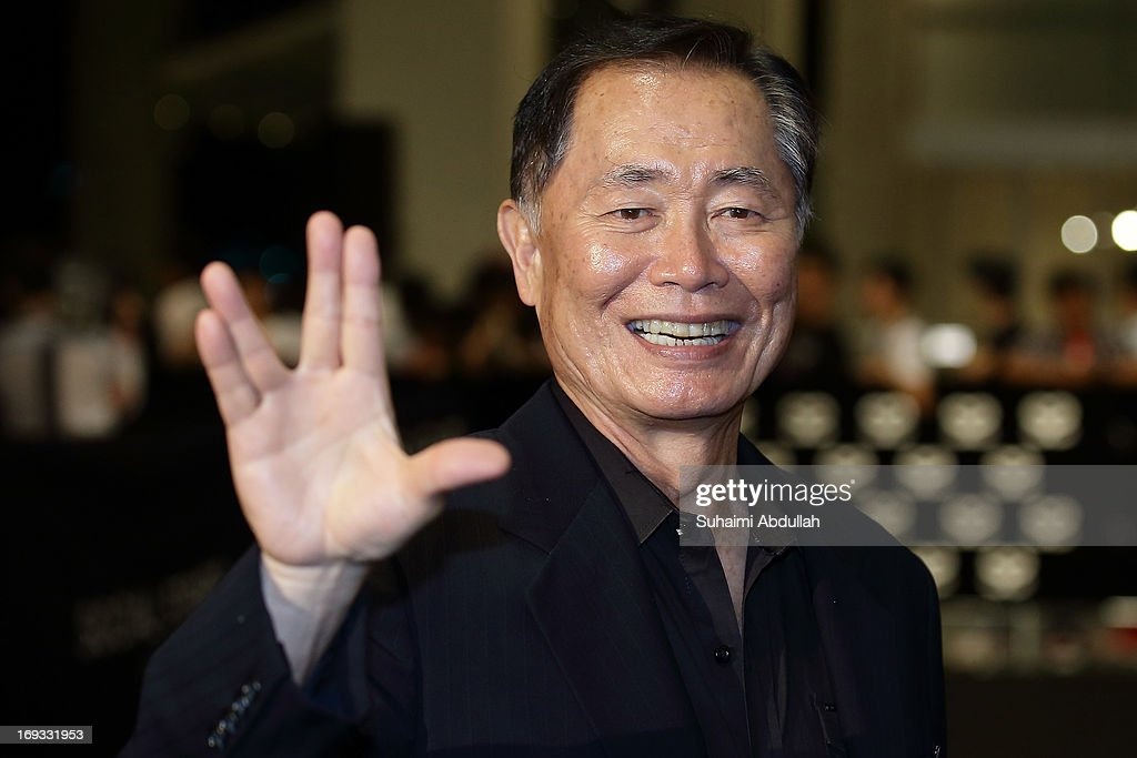 American actor and author, George Hosato Takei gestures on the red carpet during the Social Star Awards 2013 at Marina Bay Sands on May 23, 2013 in Singapore.