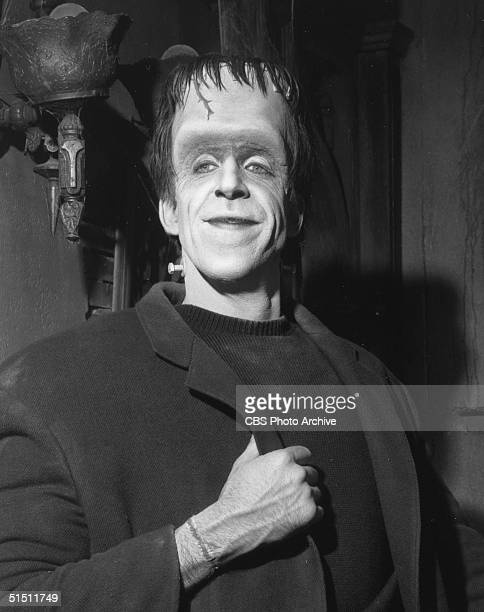 American actor and children's book author Fred Gwynne poses in costume on the set of the CBS television situation comedy 'The Munsters' 1965