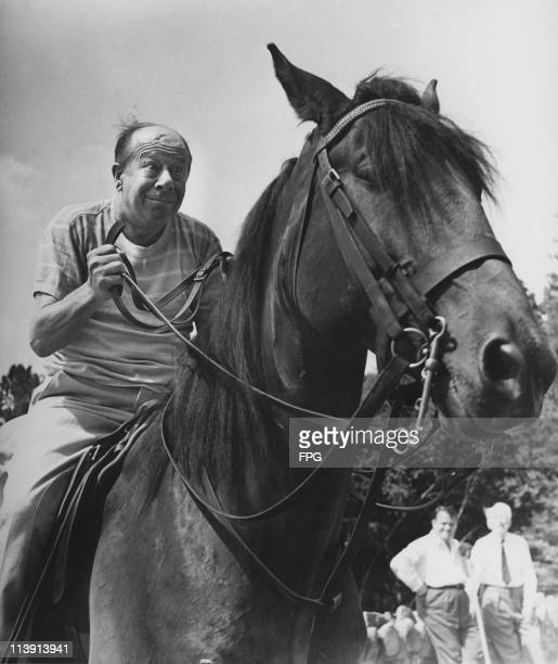 American actor and comedian Bert Lahr on horseback circa 1965