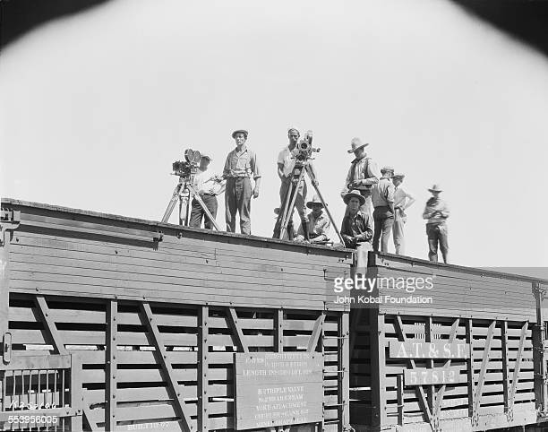 American actor and comedian Buster Keaton atop an ATSF train whilst filming a stunt for the film 'Go West' USA 1925