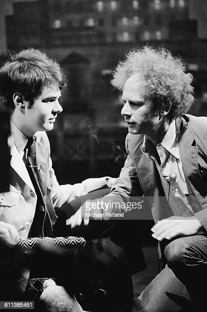 American actor and comedian Dan Aykroyd with singer Art Garfunkel at rehearsals for the NBC comedy sketch show 'Saturday Night Live' New York City...