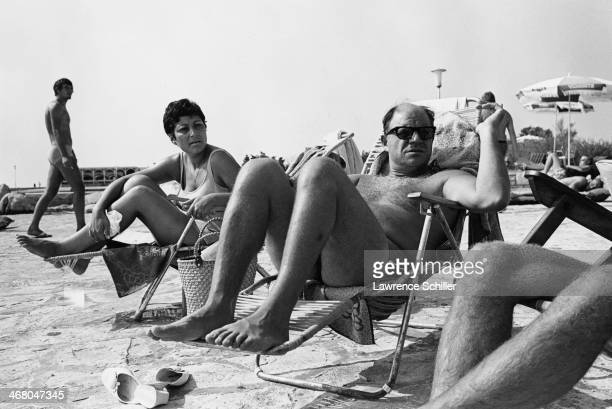 American actor and comedian Don Rickles and his wife Barbara Rickles sunbath during the prodction of the film 'Kelly's Heroes' Vizinada Croatia 1969