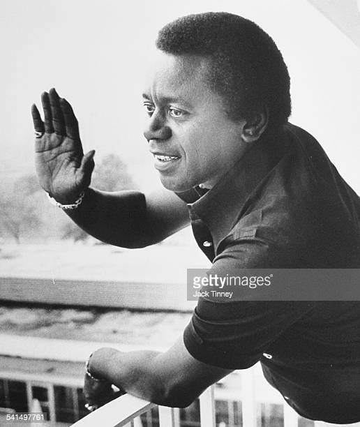 American actor and comedian Flip Wilson waves hello from a balcony Philadelphia Pennsylvania 1975