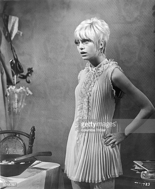 American actor and comedian Goldie Hawn stands in a pleated babydoll with her mouth agape in a still from the film, 'Cactus Flower', directed by Gene...