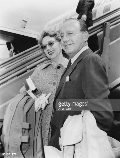 American actor and comedian Jack Benny and his wife actress Mary Livingstone arrive at London Airport 22nd July 1957 Benny is in Britain to discuss...