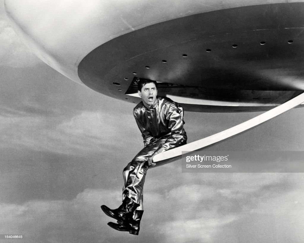American actor and comedian Jerry Lewis, as Kreton, sitting on the entrance ramp of a flying saucer in 'Visit To A Small Planet', directed by Norman Taurog, 1959.