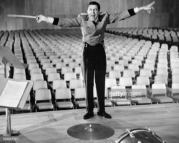 American actor and comedian Jerry Lewis as Stanley the bellboy conducting an imaginary orchestra in an empty theatre in 'The Bellboy' 1960 Lewis also...