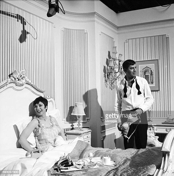 American actor and comedian Jerry Lewis seen here with actress Jacqueline Pearce during a break in filming Don't Raise the Bridge Lower the River at...