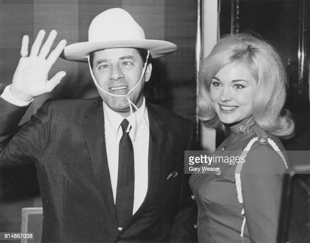 American actor and comedian Jerry Lewis with Diane Coulter Miss Dominion of Canada during a reception in his honour at the Savoy Hotel London 14th...