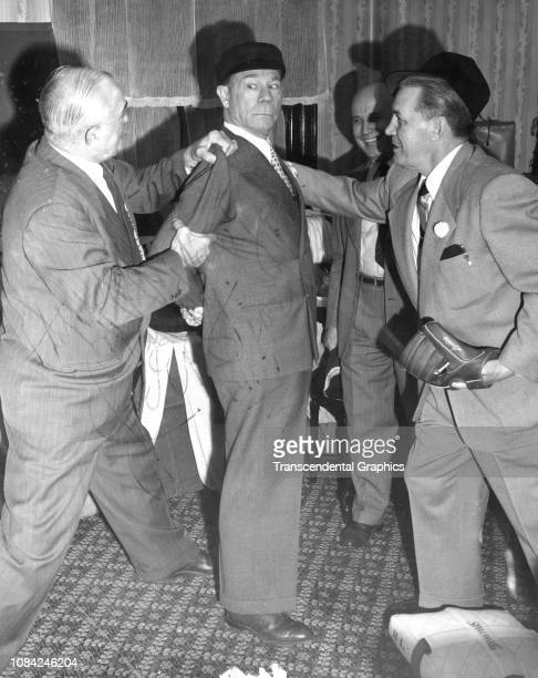 American actor and comedian Joe E Brown performs in a comic skit during the Baseball Writers' annual banquet New York New York winter 1943