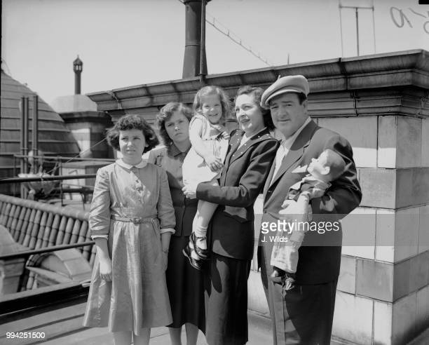 American actor and comedian Lou Costello at the Savoy Hotel in London with his wife Anne and their children Carole Paddy and Christine 29th June 1950...