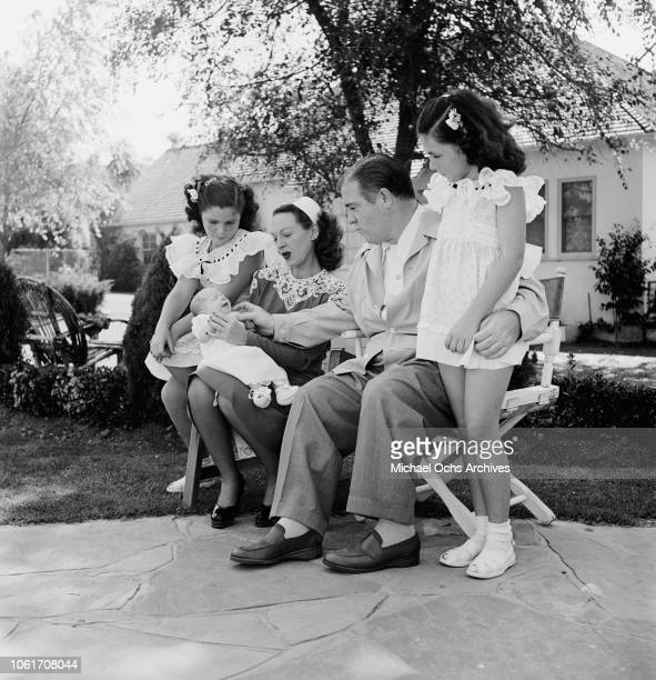 American actor and comedian Lou Costello of comedy duo Abbott and Costello with his wife Anne and their daughters Patricia or 'Paddy' Carole and baby...