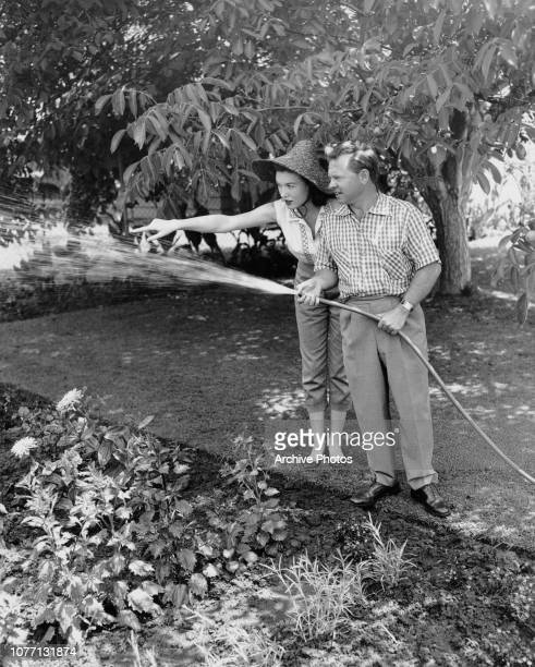 American actor and comedian Mickey Rooney with his wife actress Elaine Devry in the garden circa 1955