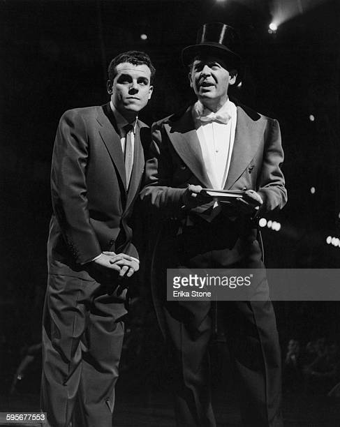 American actor and comedian Milton Berle with singer Julius La Rosa at the opening of a circus in New York City, circa 1952.
