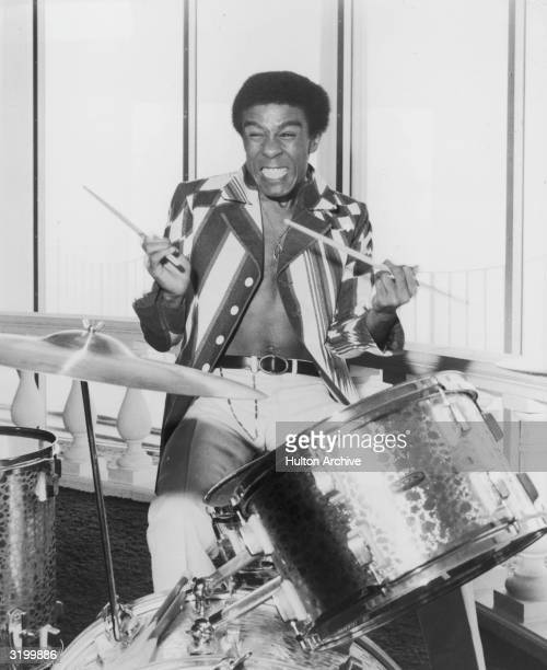 American actor and comedian Richard Pryor grimacing as he plays the drums for his role as the character Stanley X in director Barry Shear's film,...