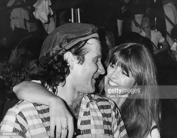 American actor and comedian Robin Williams with actress Pam Dawber at a Paramount Pictures summer wrap party Paramount Studios Hollywood June 1979...
