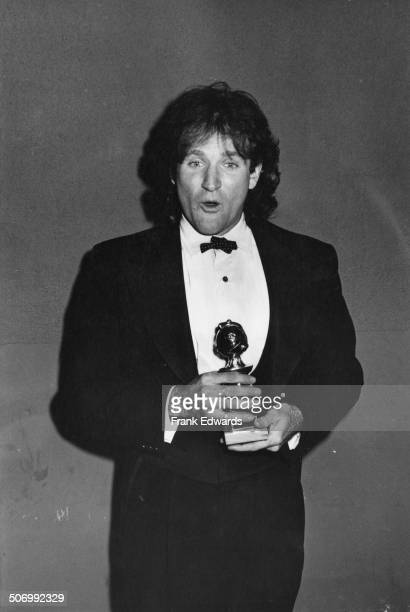 American actor and comedian Robin Williams with his award for the sitcom 'Mork And Mindy' at the 36th Annual Golden Globe Awards in Beverly Hills...