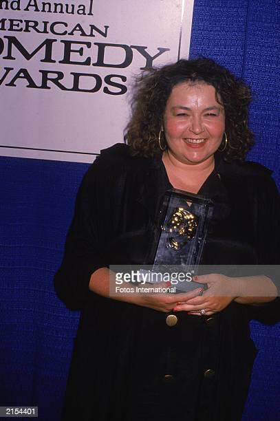 American actor and comedian Roseanne Barr holds her award American Comedy Awards Hollywood Palladium California May 17 1988