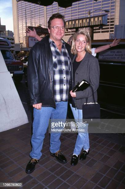 American actor and comedian Tom Arnold and his wife Julie at the 1996 NATO /ShoWest convention in Las Vegas, Nevada, March 1996.
