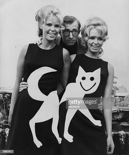 American actor and comedian Woody Allen with the Croft twins wearing 'Pussycat ' dresses to promote the film 'What's New Pussycat'