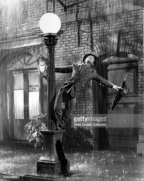 American actor and dancer Gene Kelly as Don Lockwood in 'Singin' In The Rain' directed by Kelly and Stanley Donen 1952