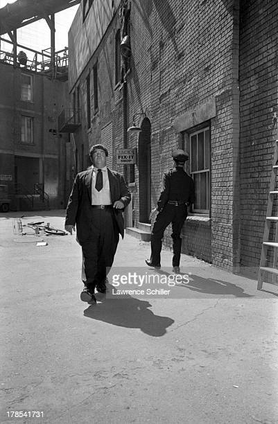 American actor and director Buster Keaton hides behind an unidentified actor in a scene from an unidentified television program Culver City...