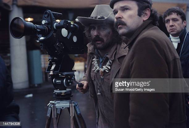American actor and director Dennis Hopper looks through the camera lens during the filming of his directorial debut 'Easy Rider' New Orleans...