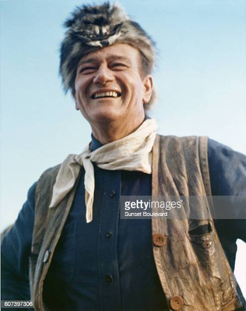 American actor and director John Wayne on the set of his movie The Alamo