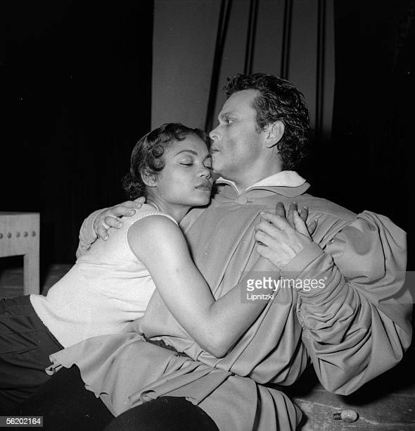 American actor and director Orson Welles on stage as Faustus with Eartha Kitt as Helen of Troy in 'Time Runs' Welles' version of the Faust legend at...