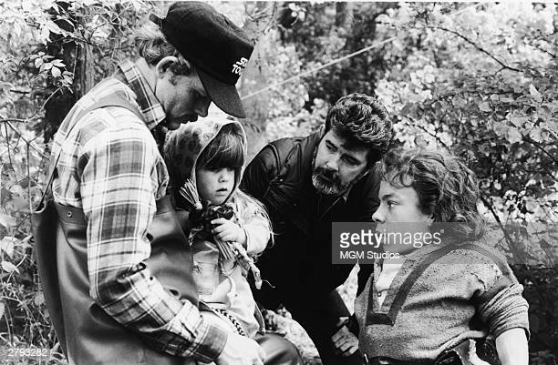 American actor and director Ron Howard actor Dawn Downing American director and producer George Lucas and British actor Warwick Davis discuss a scene...