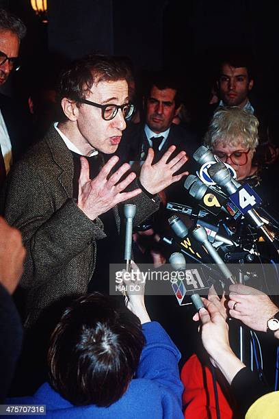 American actor and director Woody Allen speaks to the media 15 December 1992 in NewYork after a pretrial hearing in the custody fight with his wife...