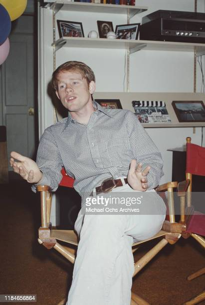 American actor and film director Ron Howard sitting in a director's chair 14th July 1978 Behind him is a clapperboard for the 1978 movie 'Cotton...