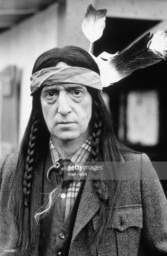 American actor and film director Woody Allen dressed in costume as a Native American in a promotional portrait for his film, 'Zelig'.