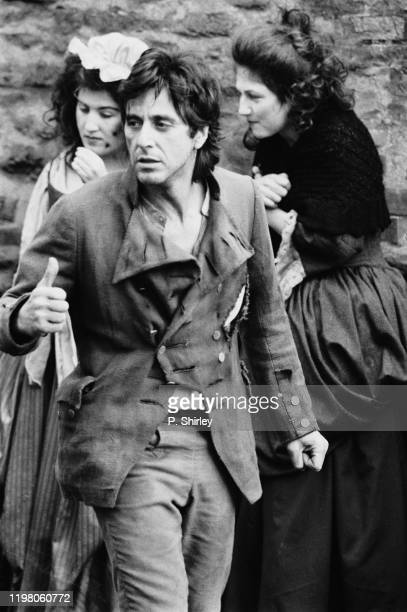 American actor and filmmaker Al Pacino in period costume as 'Tom Dobb' with extras during the filming of historical drama film 'Revolution', UK, 25th...