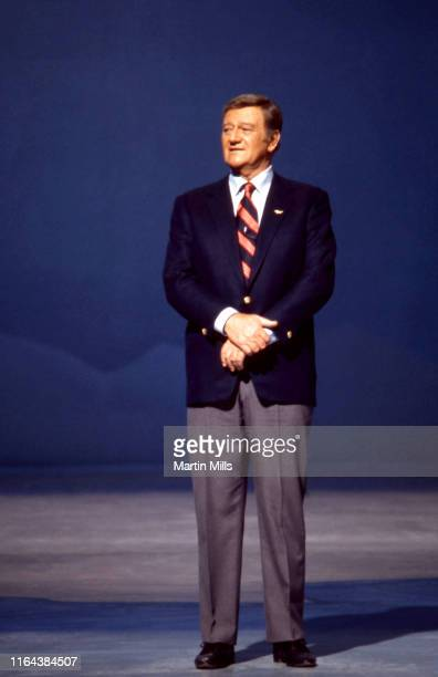 """American actor and filmmaker John Wayne talks on stage during his NBC special """"Swing Out, Sweet Land"""" airing on November 29, 1970 in Los Angeles,..."""