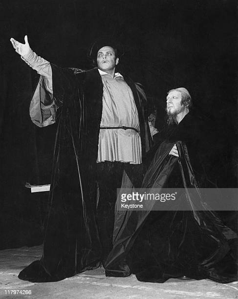 American actor and filmmaker Orson Welles as Faust with Hilton Edwards as Mephisto in Welles' stage adaptation of the Faust myth at the Theatre...