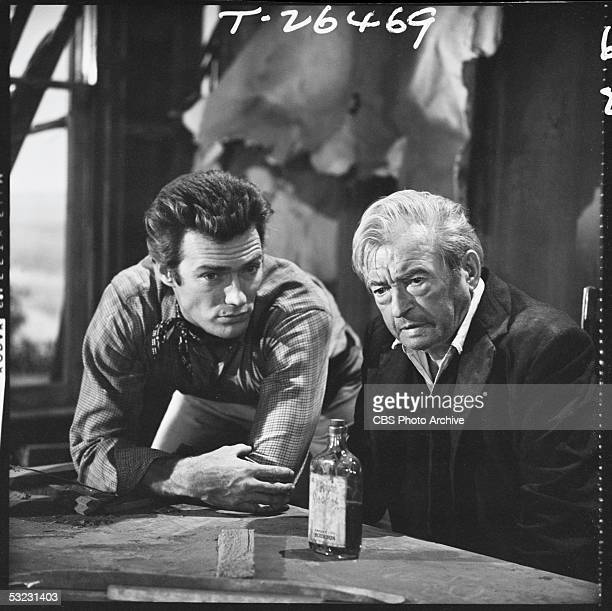 American actor and later director Clint Eastwood as Rowdy Yates appears in a scene with 'Rawhide' guest star English actor Claude Rains as Judge...