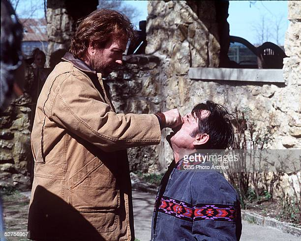 American actor and martial arts expert Chuck Norris grabs an opponent by the nose while in character as 'Walker Texas Ranger' during an episode of...