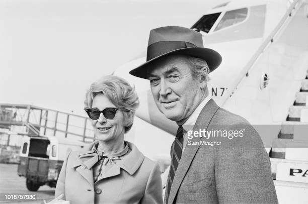 American actor and military officer James Stewart and Gloria Hatrick McLean at Heathrow Airport London UK 13th October 1966