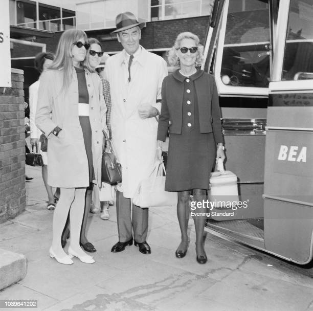 American actor and military officer James Stewart with his wife American actress and fashion model Gloria Hatrick McLean and daughters Judy and Kelly...