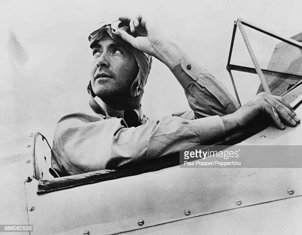 American actor and musician, Charles Buddy Rogers sits in the cockpit of his aircraft as he trains for his wings during World War Two, at the Naval...