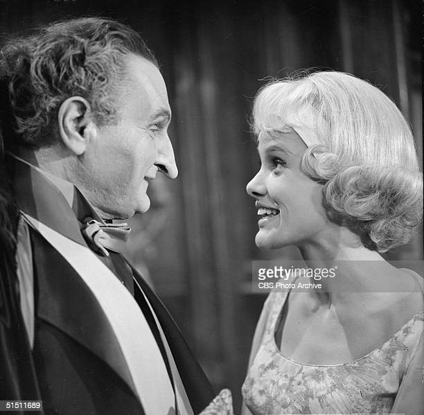American actor and piolitical activist Al Lewis and actress Beverly Owen in a still from the CBS television situation comedy 'The Munsters' episode...