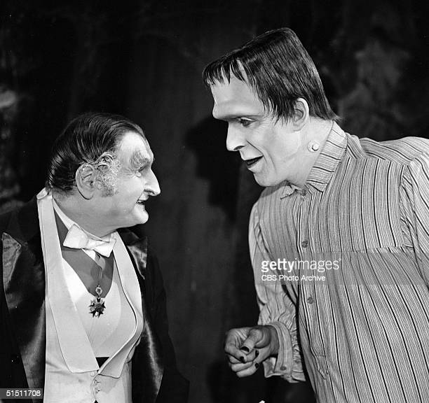 American actor and political activist Al Lewis talks to actor and children's book author Fred Gwynne in a still from the CBS television situation...